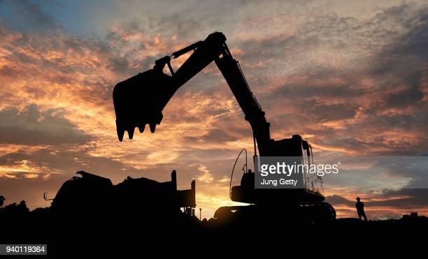 excavator blue sky heavy machine construction site soil excavate for foundation work by construction worker contractor for background construction concept - excavator stock photos and pictures