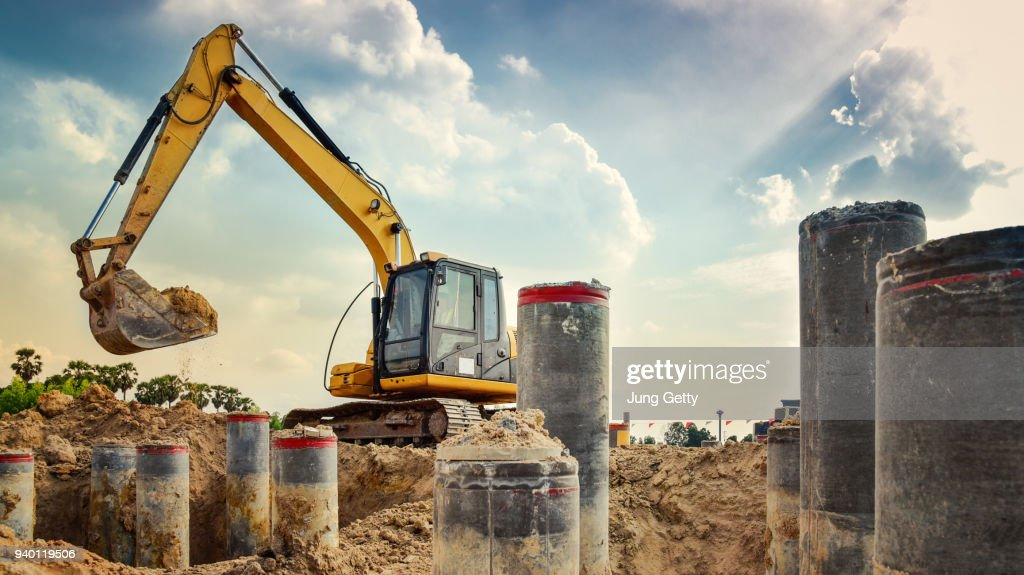 excavator blue sky heavy machine construction site soil excavate for foundation work by construction worker contractor for background construction concept : Stock Photo