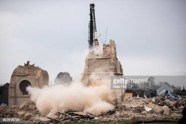 Excavator demolishes Saint Lambertus church following protests by activists on January 9 2018 in Immerath Germany The village of Immerath will be...