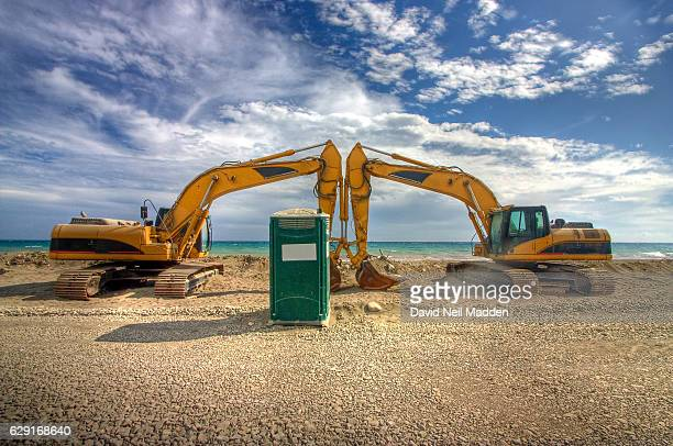 excavator earth movers - portable toilet stock photos and pictures