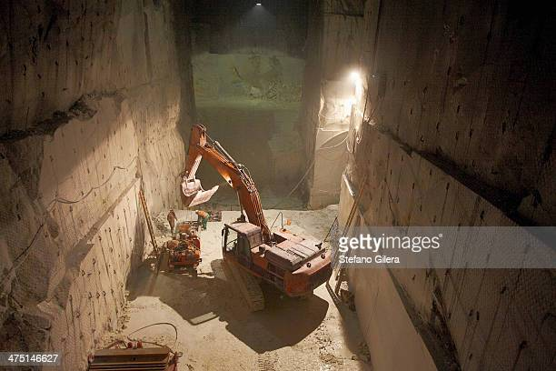 excavator in a marble quarry - underground mining stock photos and pictures