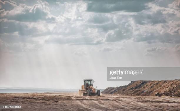 excavator in construction site - kolgruva bildbanksfoton och bilder
