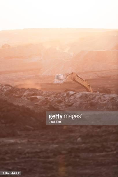 excavator on construction site - kolgruva bildbanksfoton och bilder