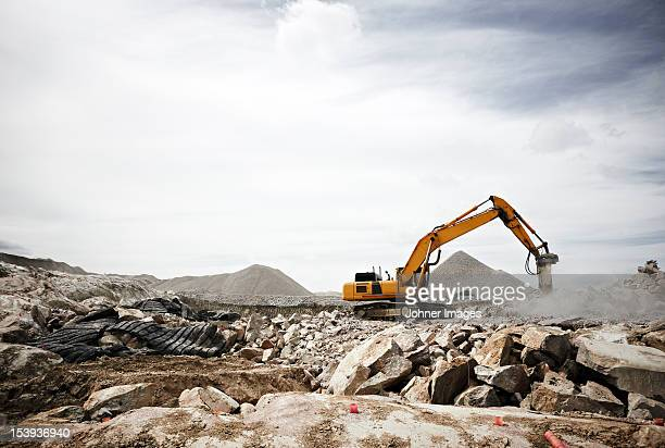 excavator on construction site - excavator stock photos and pictures
