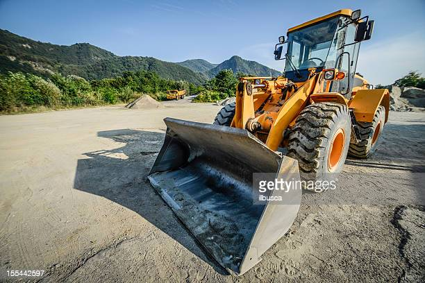 excavator - scraping stock photos and pictures