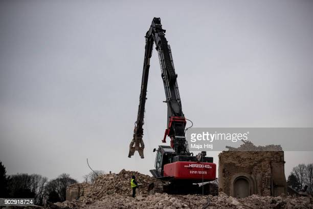 Excavator stands after demolition of Saint Lambertus church following protests by activists on January 9 2018 in Immerath Germany The village of...