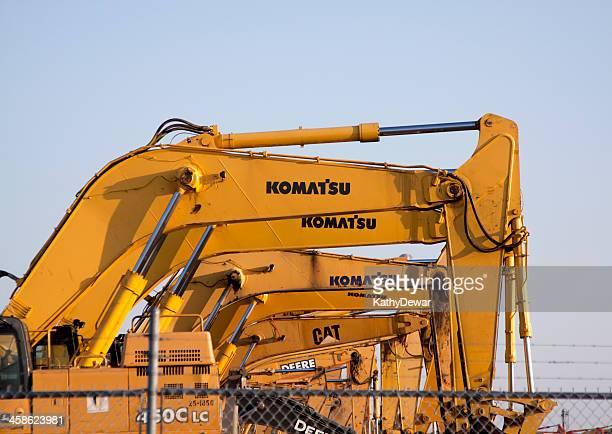 excavator trucks - komatsu stock pictures, royalty-free photos & images