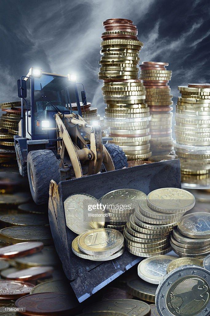 Excavator with Euro coins : Stock Photo