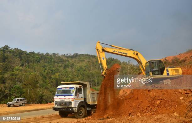 Excavator works in widening of road for Asian Highway 1 to Four Lane from Dimapur to Zubza road at Medzhiphema outskirt of Dimapur India north...
