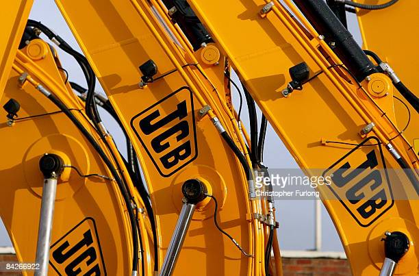 JCB excavators and earth moving equipment sit in the yard of a dealers on January 13 2009 in Manchester England The famous yellow liveried excavation...