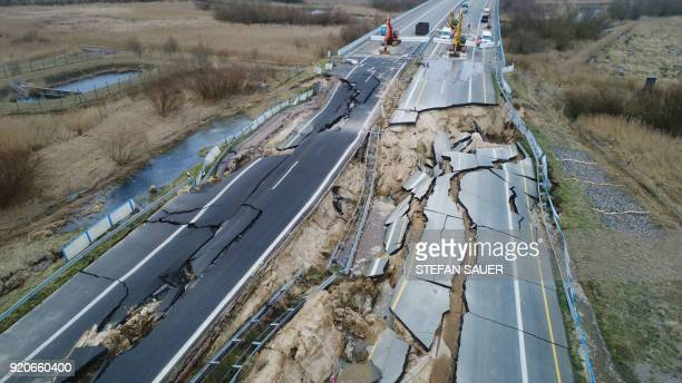 TOPSHOT Excavators are ready to dismantle the road dam on the cutoff section of the A20 motorway at the site of an unexplained landslide near...