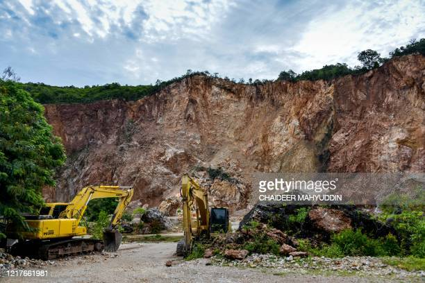Excavators are seen next to an illegal sand quarry at Pekan Bada at Pekan Bada, near Banda Aceh on June 5, 2020.
