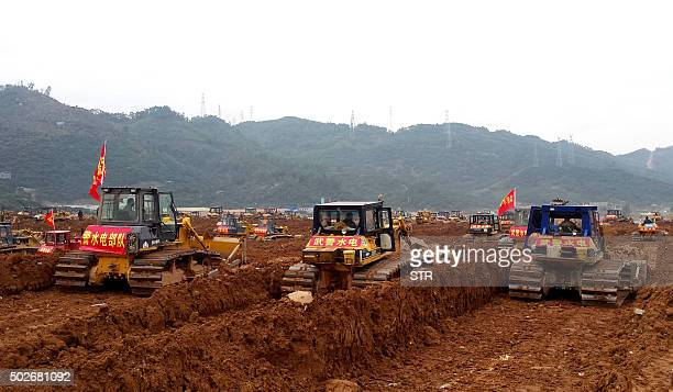 Excavators are seen working at the site of the landslide in an industrial area in Shenzhen south China's Guangdong province on December 28 2015 The...