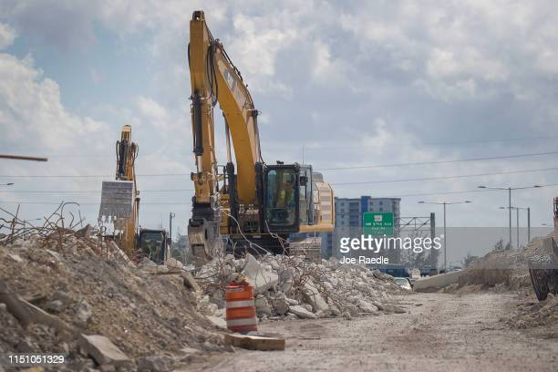 Excavators are used as workers continue building a newer State Road 836 on May 22 2019 in Miami Florida President Donald Trump walked out of a...