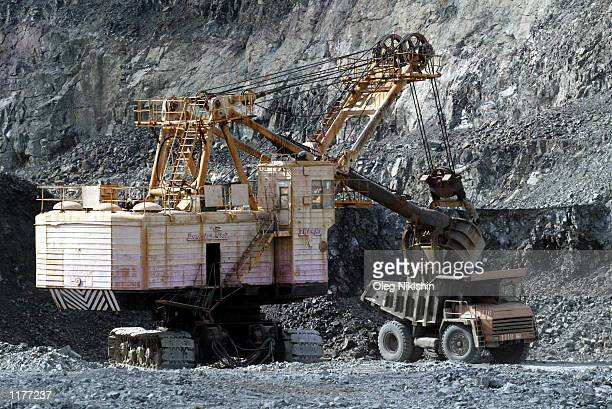 Excavators load ore in a dumpster July 17 2002 in the Medvezhya mountains near Norilsk Russia In total Norilsk produces over 90 percent of Russia's...