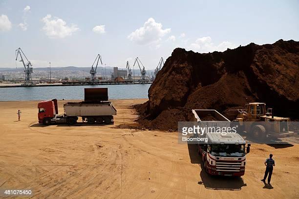 Excavators load trucks with unprocessed nickel ore on the dockside at Thessaloniki port operated by Thessaloniki Port Authority SA in Thessaloniki...