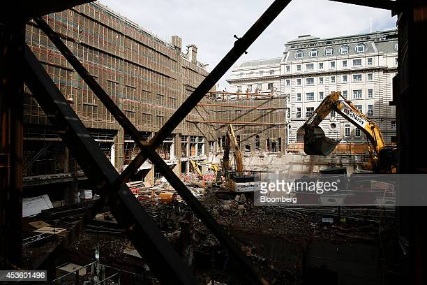 Excavators maneuver rubble during building works at Balfour Beatty Plc's St James's Market construction site a joint Crown Estate and Oxford...