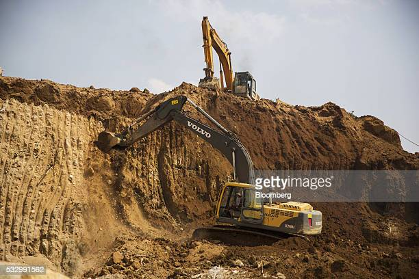 Excavators move earth at the Lian Shan open pit ruby mine in Mogok Mandalay Myanmar on Tuesday March 15 2016 In a remote region of Myanmar a country...