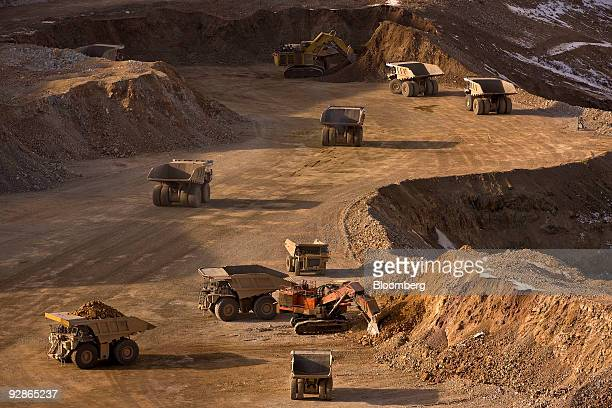 Excavators move earth into mining trucks at the AngloGold Ashanti Ltd Cripple Creek Victor gold mine in Victor/Cripple Creek Colorado US on Thursday...