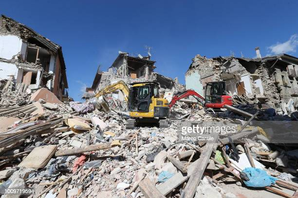 Excavators on the rubble of a two houses completely collapsed after the earthquake that hit the city of Amatrice in central Italy