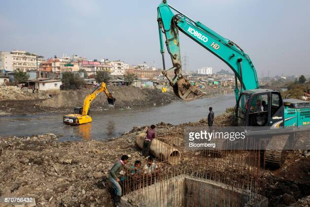 Excavators operate at a construction site along the Bagmati River in Kathmandu Nepal on Wednesday Nov 1 2017 India and China have often jostled for...
