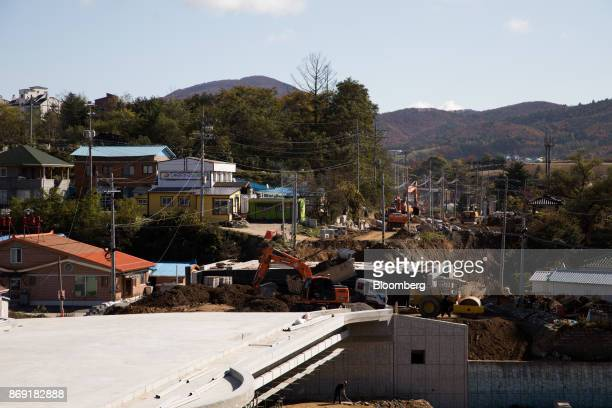 Excavators operate at a construction site in Hoenggyeri village area of Pyeongchang Gangwon South Korea on Friday Oct 20 2017 With less than 100 days...