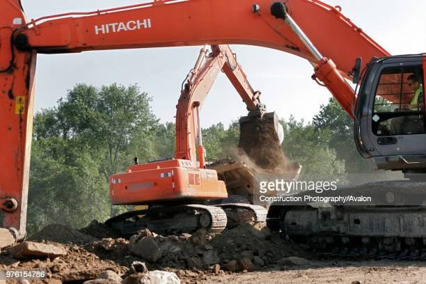 Excavators.