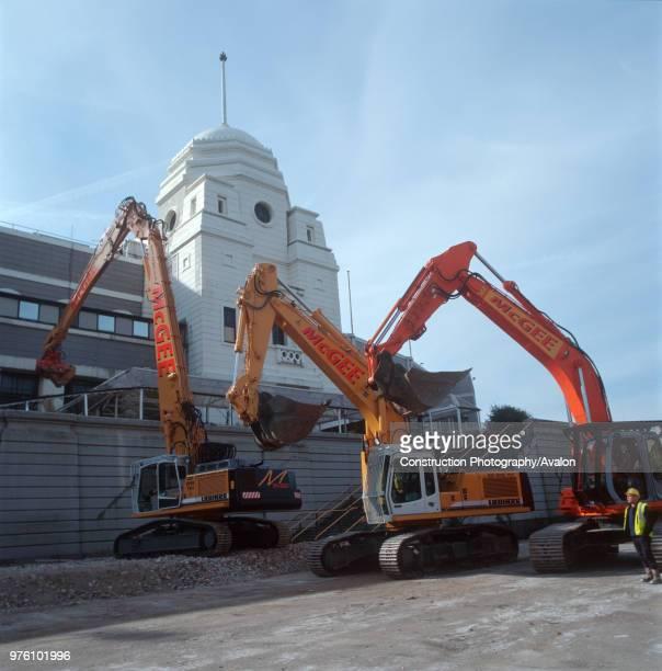 Excavators preparing to begin demolishing Wembley Stadium London United Kingdom