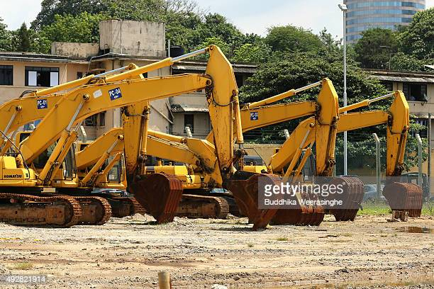Excavators stand in Chinese funding Colombo Port City Project site on October 15 2015 in Colombo Sri Lanka Sri Lankan new government under the...