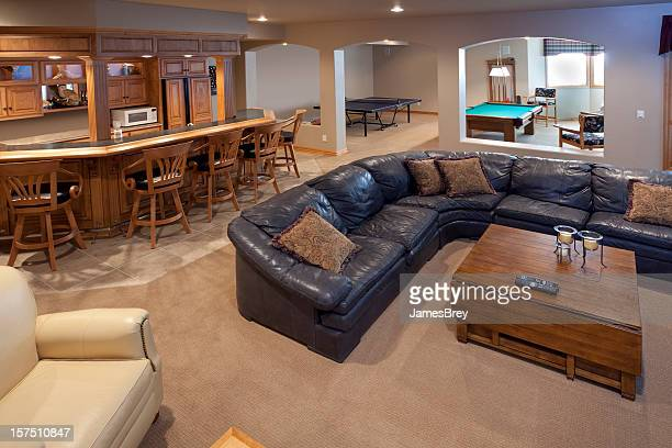 excellent finished basement bar, lounge, game room, pool table, sofa - finishing stock pictures, royalty-free photos & images