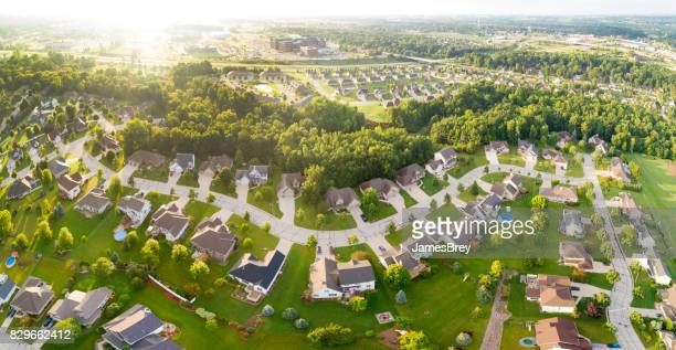 Exceptionally beautiful neighborhoods, homes, aerial view at sunrise
