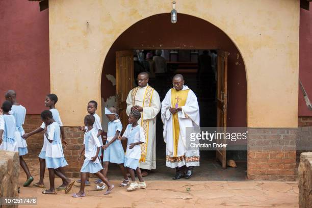 Excerpt of priests with altar server after the service in Zimbabwe on a mission station in Zimbabwe