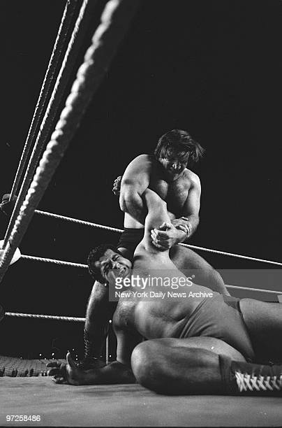 Ex-champ Bruno Sammartino has an armlock on World Wide Wrestling Federation champ Pedro Morales during bout staged before 20,000 freezing fans at...