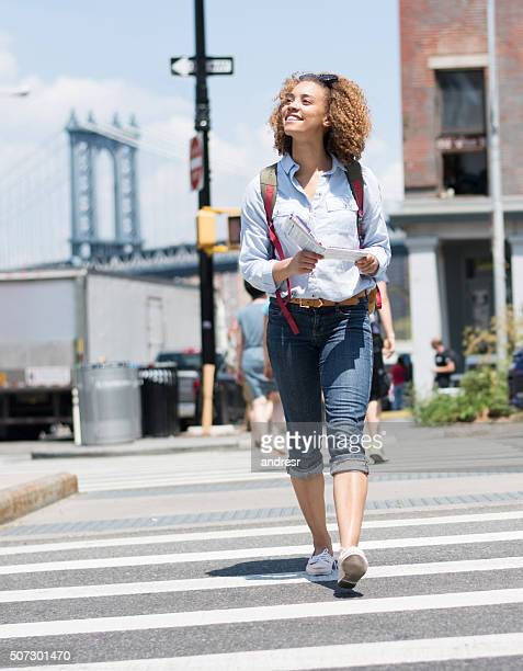 exchange student walking around the city with a map - one young woman only stock pictures, royalty-free photos & images