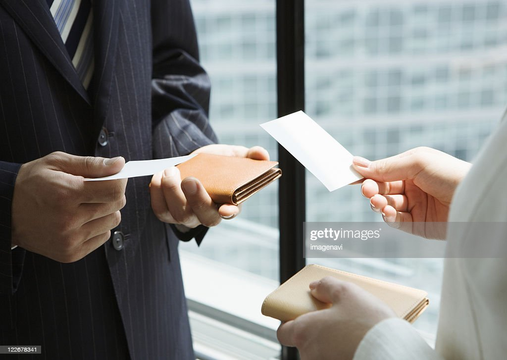Exchanging business cards stock photo getty images exchanging business cards stock photo colourmoves