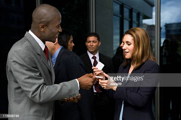 Business card stock photos and pictures getty images exchanging business cards reheart Image collections