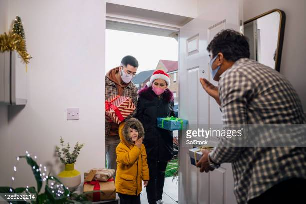 exchanging gifts at a safe distance - guest stock pictures, royalty-free photos & images