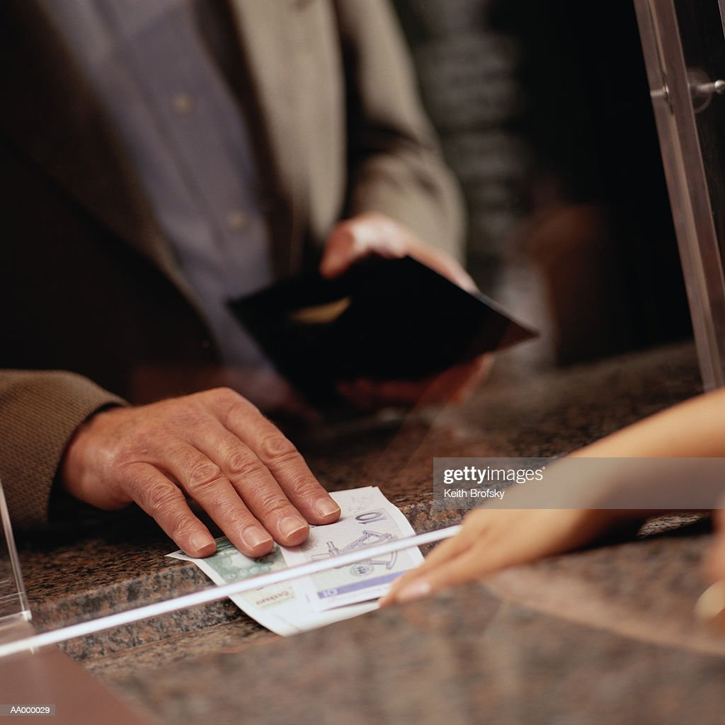 Exchanging Money at a Currency Exchange : Stock Photo