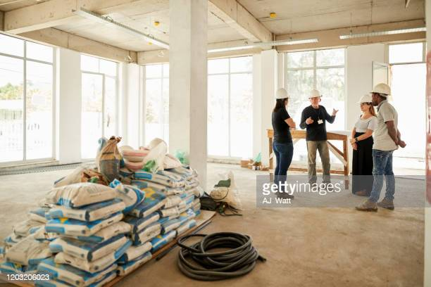 exchanging some important tricks - construction material stock pictures, royalty-free photos & images
