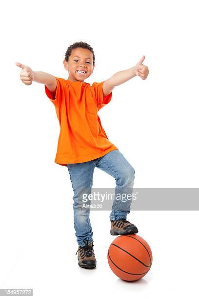 Excited 8-year old mixed race boy with basketball