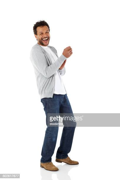 Excited african man laughing at camera