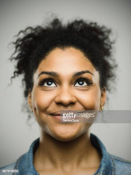 excited afro american woman smiling against gray background - part of a series stock pictures, royalty-free photos & images