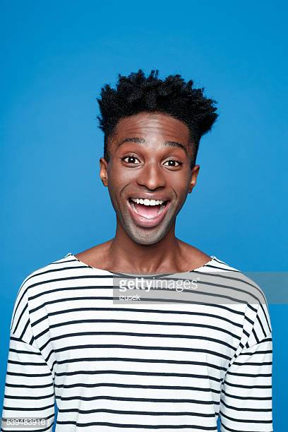 excited afro american young man - black people laughing stock photos and pictures