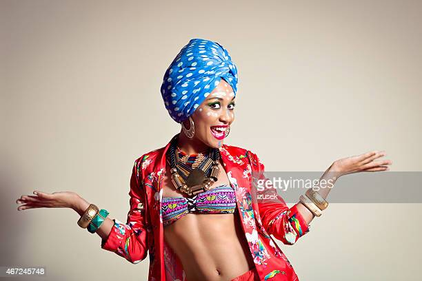 excited afro american young woman wearing blue turban - crazy holiday models stock photos and pictures