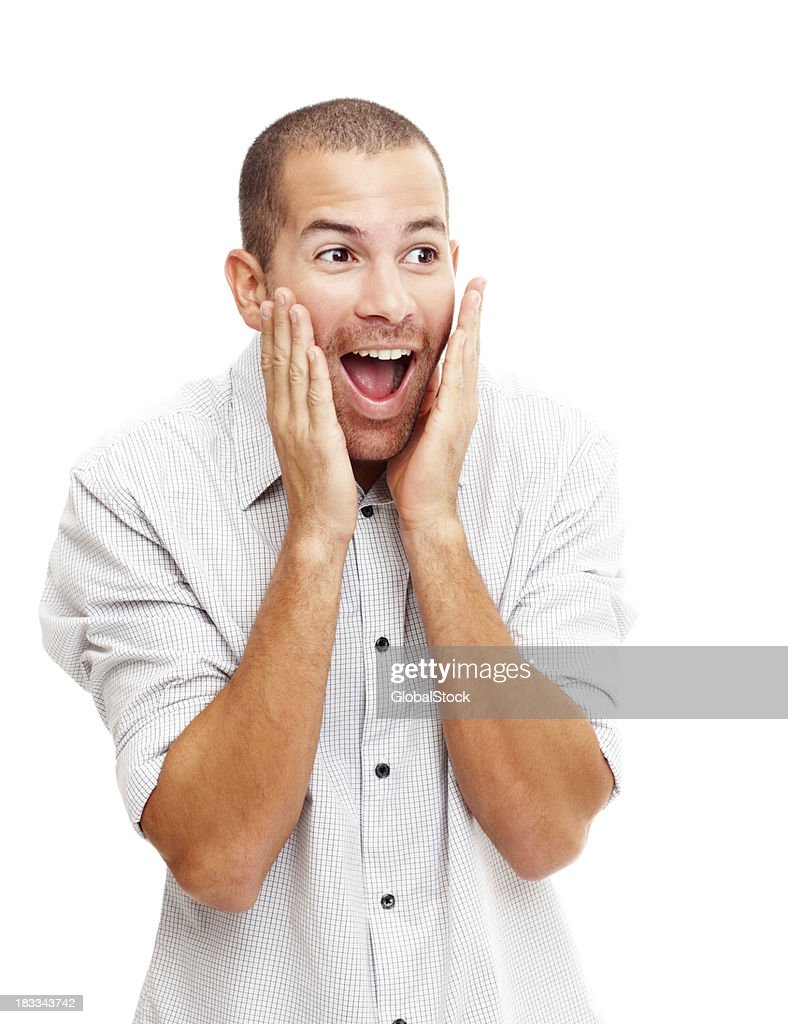Excited and surprised young man on white : Stock Photo
