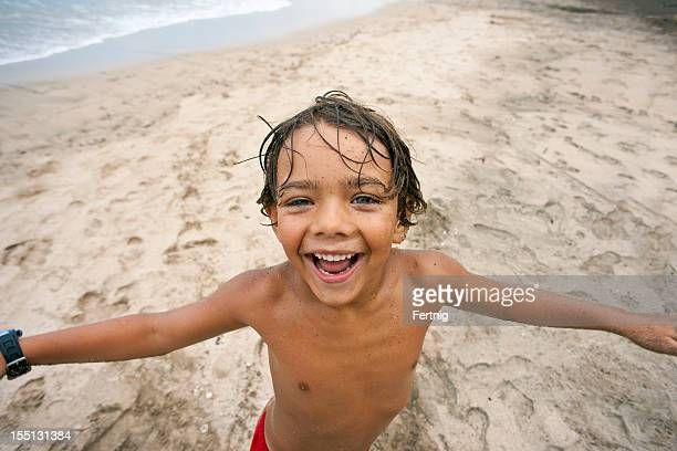 excited at the beach - southern european descent stock pictures, royalty-free photos & images