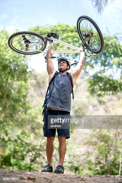 Excited biker achieving his goal
