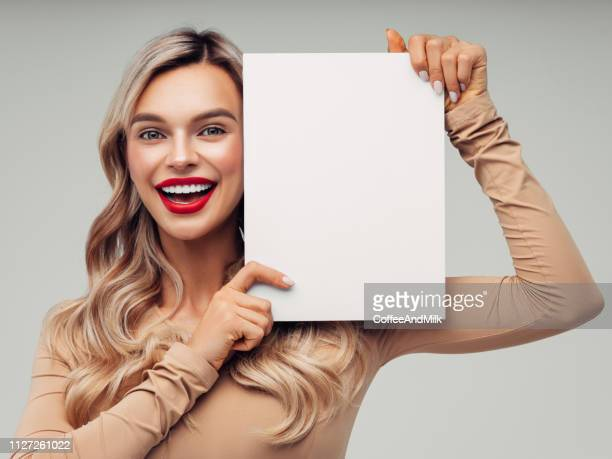 excited blond woman is holding placard - beautiful bare women stock pictures, royalty-free photos & images