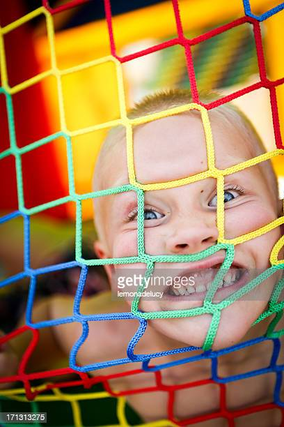 Excited boy in bounce house at a summer party