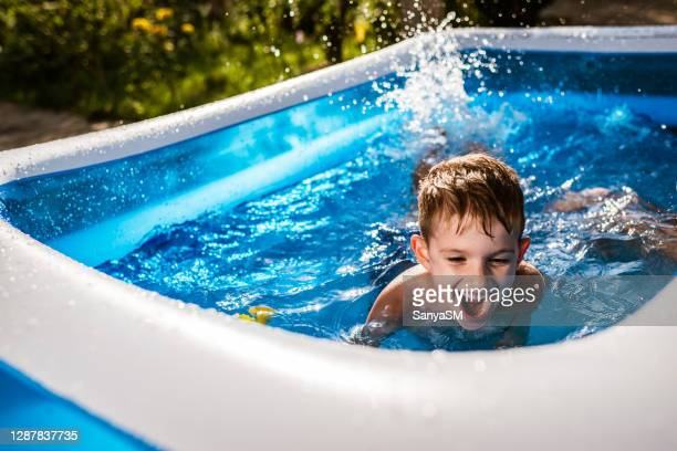 excited boy in swimming pool - kids pool games stock pictures, royalty-free photos & images